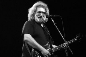 Jerry Garcia of the Grateful Dead playing guitar onstage