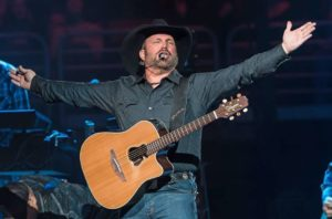 Garth Brooks addresses the crowd with his GB7C Signature Acoustic Guitar by Takamine