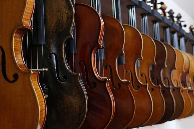 Different size violins side by side