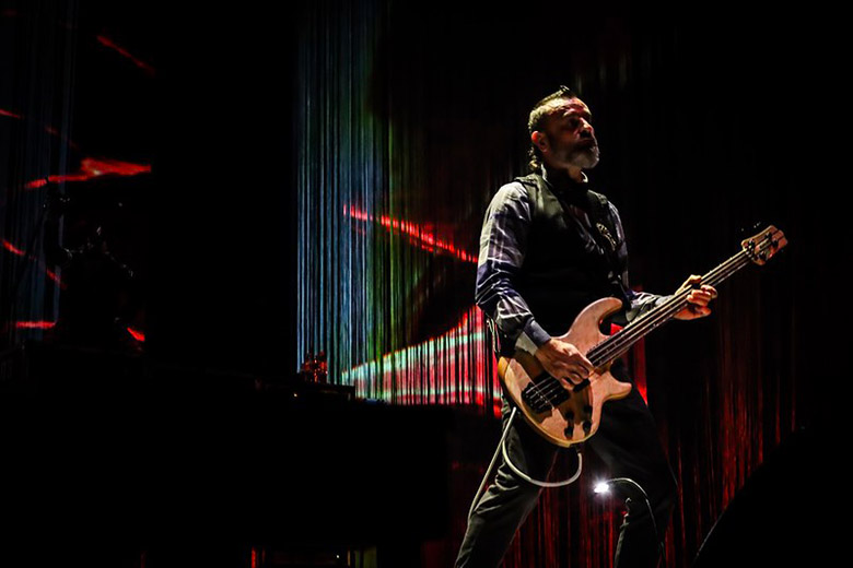 Justin Chancellor Playing one of the Types of Bass Guitars