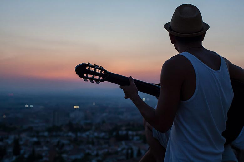 Man Playing an Easy Spanish Guitar Song