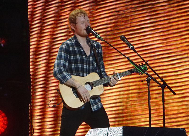 Ed Sheeran Playing a Guitar Song Using a Capo