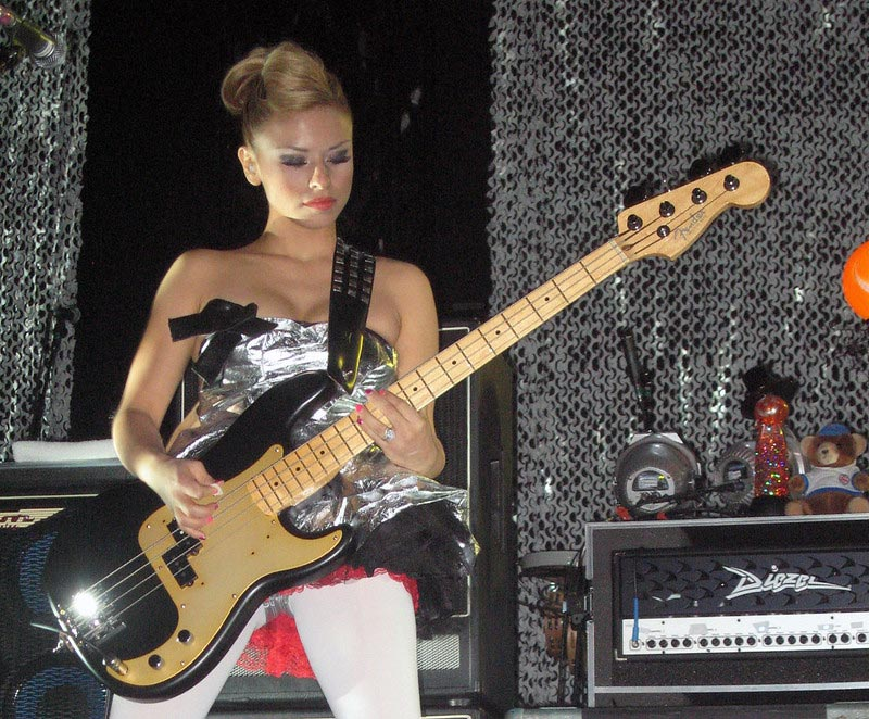 Female Bass Player Ginger Pooley Performing Live